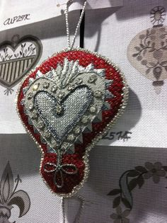 Crown ornament by KreinikGirl, via Flickr. Needlepoint canvas is by Ann Wheat Pace.