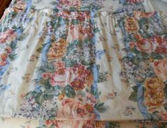 Lovely old roses and lilacs in soft pinks and blues make perfect cottage chic valances for a bedroom. The fabric is high quality drape material purchased from In The Beginning. The valances are deep and lined, so that the...