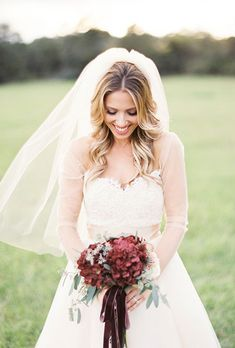 Brides.com: . A bold bouquet comprised of burgundy hydrangeas and greenery, created by Belle Soul Weddings.