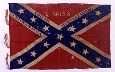 "Pattern: Army of Tennessee battle flag. Unit Designation: In white appliqué, ""7 MISS"" Battle Honors: In black paint, ""SHILOH"", ""CHICKAMAUGA"", and ""MURFREESBORO"".Requisitioned in January 1864 by Lt. Col. Benjamin Franklin Johns. Captured at the battle of Jonesboro, GA-1864 by Capt. John A. Smith, 57th Ohio Veteran Volunteer Infantry. The flag had been presented to Mr. Dawson, the donors' father, ""by a Confederate soldier, who broke the window of a store in Bellefontaine, OH, and recaptured…"