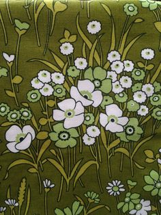 Cheery 1970s green hued, large print floral curtains in a heavy duty 75% cotton/25% polyester cloth, fully lined.  162 cm wide (each), 177 cm drop, unused.  St Michael's finest!