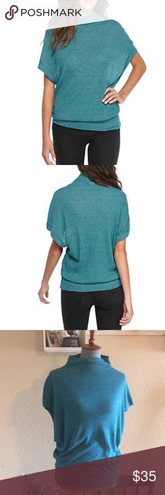 Free People Madeline Rib Knit Top Turquoise Free People Madeline Rib Knit Top  New with tag  Size: XS Color: Turquoise  Drop shoulders on an oversized turtleneck silhouette make the Madeline Rib Knit Top from Free People a chic must-have. Wear this warm and snuggly sweater with skinny jeans and classic booties for an ideal on-trend look. * Pullover * Turtleneck * Short drop shoulder sleeves * Machine washable * Cotton, polyester Free People Tops Tees - Short Sleeve