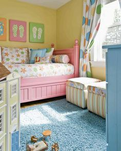 Love the pink bed, yellow walls, OK, the whole entire color palette