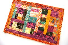 Patchwork Mini Quilt in Tropical Batik Fabrics, Colorful Quilted Mug Rug, Candle Mat, Small Place Mat by MyBitOfWonder on Etsy https://www.etsy.com/listing/254317376/patchwork-mini-quilt-in-tropical-batik