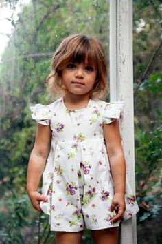 Right Bank Babies' romper hits the sweet spot with the marriage of a nostalgic floral print and clean, crisp pleats. www.rightbankbabies.com