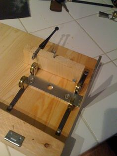 Homemade bottle cutter. Not much for instructions, but easy to view photos for ideas.