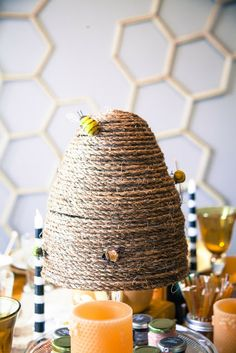 My Musings: Queen Bee Tea Party Great Details, want to try and craft some sort of bee hive like this from twine, also I really like the idea of clothes pins to hold antique bee pictures over the food table. Not 100% sold on the popsicle stick honeycombs, but maybe something similar?