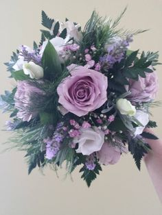 This is a stunning bridal bouquet where I have used various lavender colour flowers and some foliage.