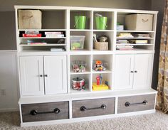 amazing diy playroom storage plans by ana-white.com love the pipe handles and wood drawers! inspired by potterybarnkids cameron storage wall system