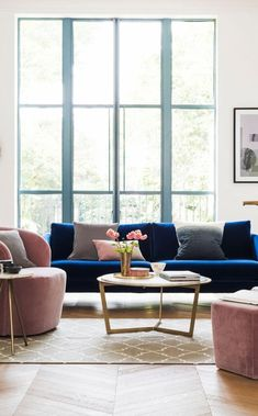 The Tivoli two-seater sofa in indigo velvet. This deep blue tone in velvet is sure to make a statement. A simple mid-century inspired sofa, the Tivoli brings a little architecture to your living room Blue And Pink Living Room, Blue Velvet Sofa Living Room, Blush Living Room, Blue Living Room Decor, Living Room Color Schemes, Living Room Chairs, Living Room Designs, Blue Sofas, Living Room Ideas Velvet