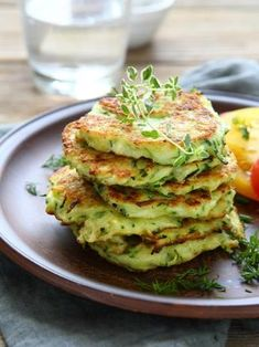 Zucchini and Parmesan Pancakes Recipe with Parmesan cheese, green onion, and oregano. Recipes With Parmesan Cheese, Zucchini Pancakes, Cooking Recipes, Healthy Recipes, Pancake Recipes, Side Dish Recipes, Vegetable Recipes, Food Inspiration, Food Dishes