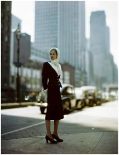 Model in cityscape wearing navy blue suit with Russian ermine trim from Kraus together with ermine hood by Sally Victor 1946  Photo Constant...