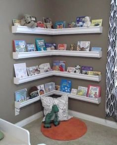 DIY Kids Room. Book shelves made out of rain gutters. Add a little color to them and I think it is SOOOOOO cute!!!