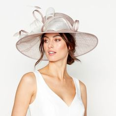 ttending a wedding this summer and a need special something to finish off your outfit? The latest styles of occasion hats, fascinators and hatinators (yes they're a thing!) are here and they're are plenty of options for mother of the brides, mother of the grooms and wedding guests. From sculptural hats to delicate fascinators, there's a style and colour to suit every outfit and hair style.