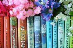idk about this pic tbh  I tried to color coordinate the flowers with the books but you can see how good a job I did there  by the.book.talk