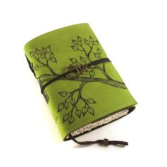 Handmade leather journal with original artwork on green suede.