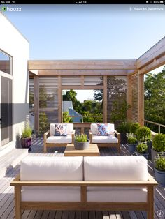 These timber panels bring some privacy and shade for this large balcony.