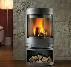 The modern HWAM 3110 helps create a warm and cozy atmosphere in your house. This elliptical hanging stove showcases design originated in pure Scandinavian lines Read Stove Heater, Pellet Stove, Into The Woods, Wood Stove Installation, Soapstone Stove, Rocket Heater, Freestanding Fireplace, Curved Wood, Wood Burning Fires