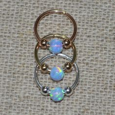 Extra Small Sterling Silver Opal Nose Ring by ModernJewelBoutique, $9.95