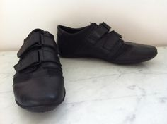 Gucci Black Leather and Toile Trainers Size 39.5 via The Queen Bee. Click on the image to see more!