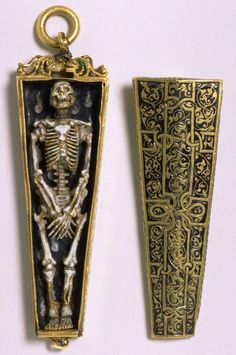 English pendant * c.1540-50, in the form of a skeleton within a coffin, a symbol of death and a memento mori.