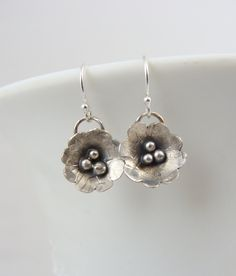 Hand forged sterling silver flower earrings