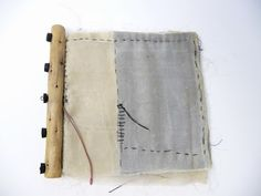 """Australian book artist Noela Mills makes fabric books with wonderful spines. This one is called """"Waxed book"""" and made from recycled kimono silks (and wax)"""
