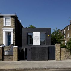 British architects Liddicoat & Goldhill constructed their own north London home using black engineering bricks and slabs of white marble.