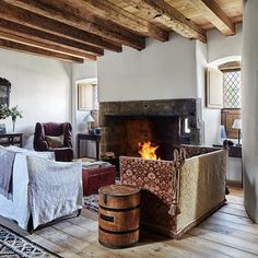 Rustic Living Room with Open Fireplace - Living Room Design Ideas on HOUSE. Living room furniture, colour schemes and wallpaper for homes small and large