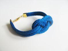 Blue rope bracelet- nautical cord sailor's knot bracelet with golden end caps. $14.00, via Etsy.