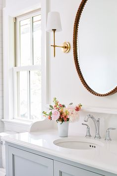 The sleek silhouette of Bryant Sconce by Thomas O'Brien in Hand-Rubbed Antique Brass highlights the clean design of the powder bathroom. Mirror and sconces for downstairs bathroom! Bathroom Vanity Designs, Bathroom Sconces, Bathroom Interior Design, Home Interior, Small Bathroom, Master Bathroom, Bathroom Accents, Bathroom Ideas, Modern Bathroom