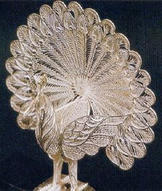 Silver filigree is one of the most exquisite renditions of silver craft.  Of all the handicrafts of Orissa the most unique and the finest, in fact the queen among them, is silver filigree, locally called tarakasi. The craft is localised at Cuttack town and a few villages in Cuttack district.
