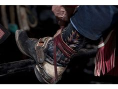 Boots worn by a bull rider at the PBR.