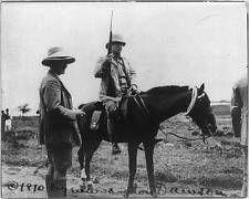 Theodore Roosevelt,horseback,holding rifle,Kermit Roosevelt,ready for game,c1910