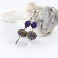 These artisan lampwork bead earrings feature gorgeous handmade lampwork beads and the ever fabulous Swarovski crystals on sterling silver. @solanakaidesign #bmecountdown