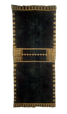 Africa   Matmata Shawl;  used as a head and upper body covering   19th century, Tunisia   Woven from wool with supplementary cotton which supplies the decorative element    After shawl is woven, it is dyed red for a newly wed bride or blue or black for older women    This is an example of an indigo dyed piece.