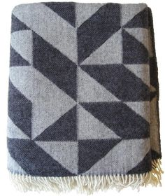 Wool twill blanket at Stilleben, a store in Copenhagen. The Twist a Twill Blanket in dark gray, designed by Tina Ratzer and made in Denmark from 100 percent virgin wool, is $139 from Gretel.