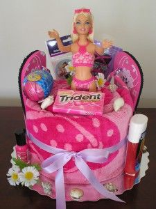 Barbie towel cake- cute idea for a pool party or a gift for a birthday girl.  Could use different towels with different themes and accessorize with coordinating accessories.