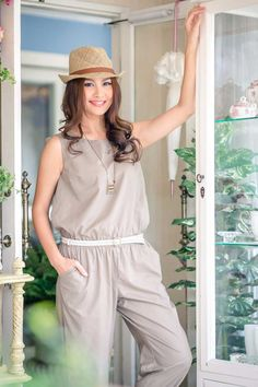 This jumpsuit design features a sleeveless top combined with long comfortable pants with an elastic waist. Featuring a back with small ties and front slit pockets.