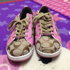 Coach shoes Pink brown and white coach shoes! Super cute but half a size too small:( only worn 3 times practically brand new Coach Shoes Sneakers
