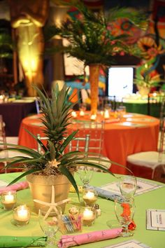 Tropical inspired centerpiece using a pineapple plant.
