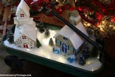 Make this DIY lighted Christmas village with fairy lights - love it in the old wagon eclecticallyvintage.com