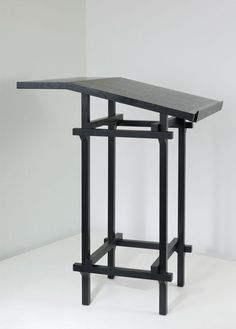 Guenther Uecker. 'Lettera' high desk, designed in 1982. H. 130 x 90 x 98 cm. Made by Rosenthal, Espelkamp. Wood, painted black. Marked: Maker's mark, quote of the designer. http://www.liveauctioneers.com/item/11777790_guenther-uecker-lettera-high-desk