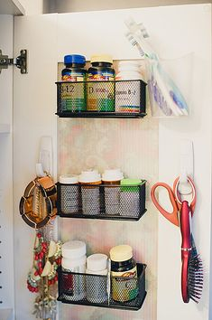 Hang brushes on command hooks. I like the vitamin storage on the door.