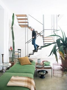 How to Create A Cohesive Look - The Effortless Chic -Floating Staircase with Indoor Plants and Green Upholstery