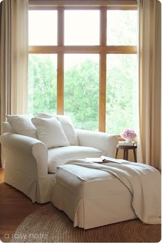 overstuffed comfy chair in front of a window, pillows, soft blanket and a good book to read as the sun goes down. *Peace*