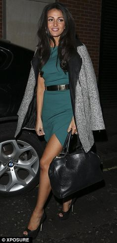 Leggy lady: Michelle showed off her slim pins in the sexy dress...x