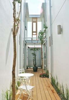 Image 25 of 25 from gallery of Gemala House / LUWIST. Compact House, Narrow House, Small Apartment Decorating, Outside Living, Japanese House, House Roof, Outdoor Landscaping, Tropical Houses, Next At Home