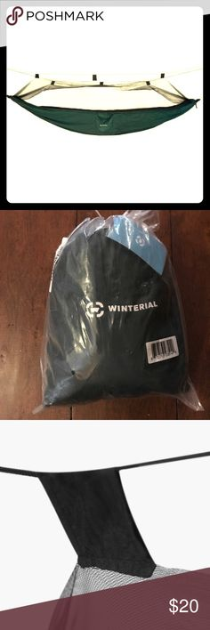 Brand New Winterial hammock w mosquito net Brand New, in plastic Winterial hammock  Including a detachable mosquito net And hardware/ropes so it is ready to hang  Perfect for your next adventure or just an afternoon reading in the sunshine Other