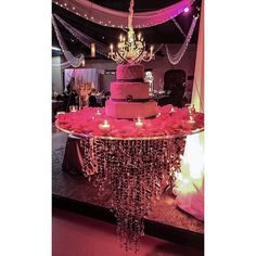 Here is a look at the suspended cake table I designed. Thanks to @nashvilleeventdraping for bringing our table vision to life and @nashville_audio_visual for the lighting! Nashville wedding planner, Paige Brown Designs